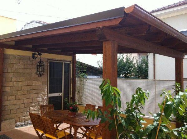 Pergola in legno lamellare tradizionale e telo fisso bologna for Disegni veranda anteriore