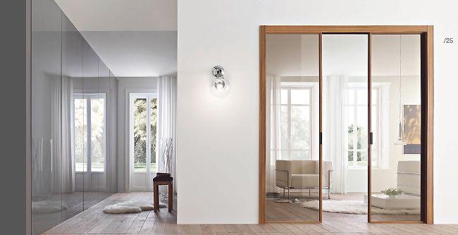Porta interna in metallo e vetro apertura scorrevole a - Porta in vetro scorrevole ...